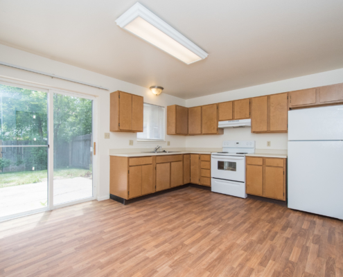 Picture showing the kitchen in the unit. It comes with a refrigerator, range, and sink.